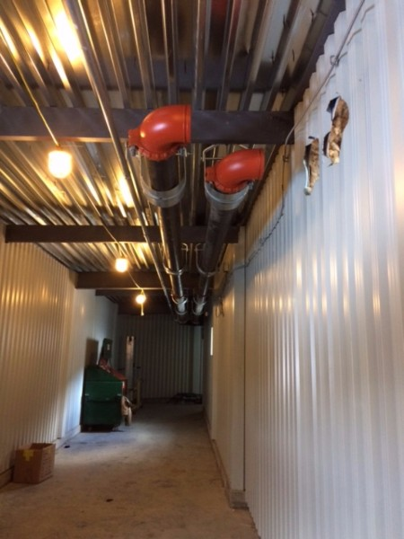 Large diameter heat pipes from the boiler room feed heat to each of the two prisons, running above ceilings in the new walkway corridors.