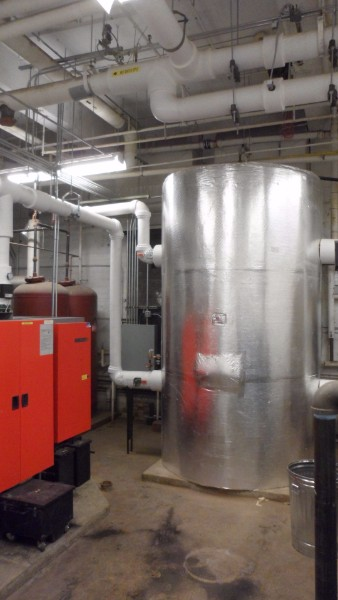 The 1000 gallon buffer tank combines with the wood pellet boilers to efficiently provide heat to the building.