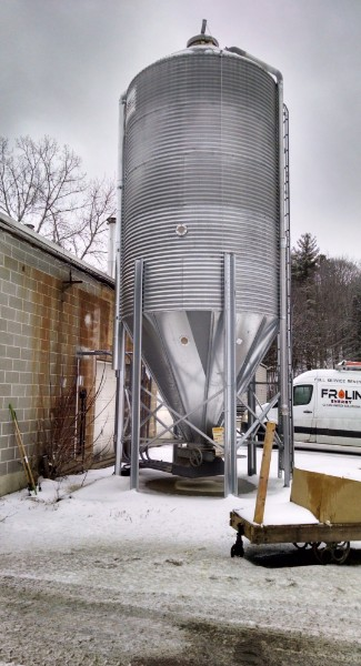 This reliable Farmer Boy exterior silo holds 20 tons of wood pellets for use by the three Froling pellet boilers.