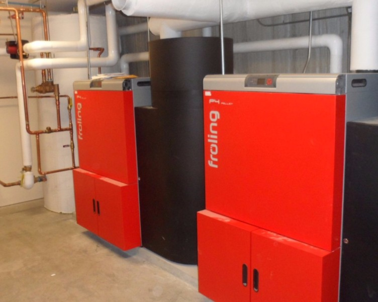 Two Froling P4-60 pellet boilers in the Monadnock Dormitory's basement provide most of the heat and hot water needed at both the gymnasium across the street.