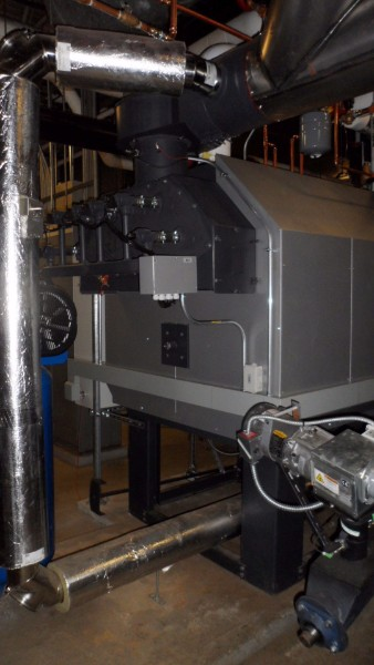 This rear view of the Viessmann Pyrot boiler (now Vitoflex 300-RF) shows the air injection cleaning system.