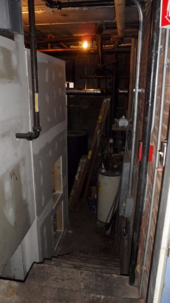 The sheetrock covered structure at left is a 6' x 6' x 10' tall pellet bin. The tall thin size was all that would fit into this very tight space.