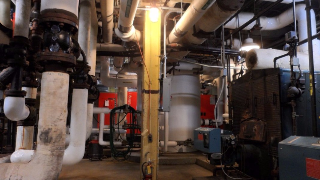 With lots of old boiler and heat distribution equipment remaining in place and active, the boiler room was very tight to work in.