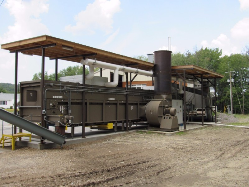 Rear view of PDC wood chip dryer shows high volume blower and control panel.