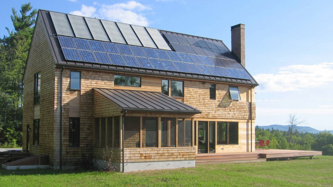 contemporary cedar shake home with  solar panels on roof