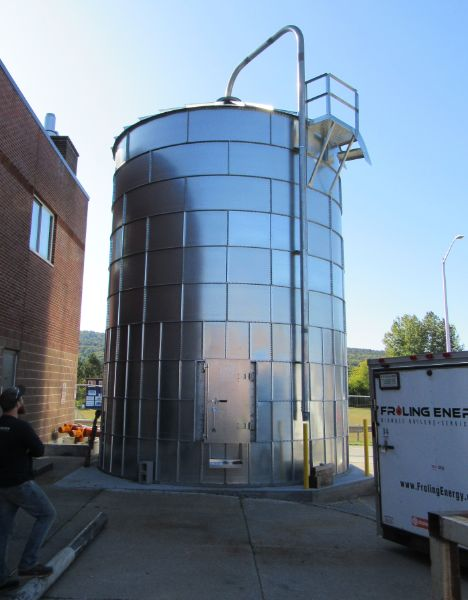 dry wood chip storage silo at Mill River Union High School is filled by a blower truck